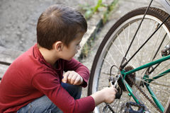 Little boy repair bicycle Royalty Free Stock Photography