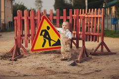 Little boy on the repaired road Stock Images