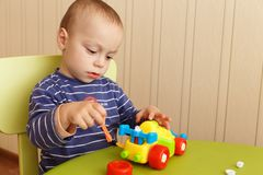 Little boy repairs auto Royalty Free Stock Images