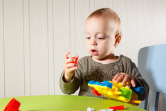 Little boy repairs auto Stock Photos