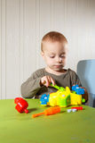 Little boy repairs auto Royalty Free Stock Photo