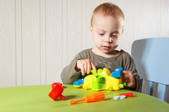Little boy repairs auto Royalty Free Stock Image