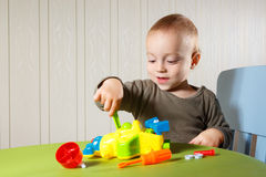 Little boy repairs auto Stock Image