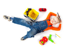 Little boy repairs his toy car Stock Photos