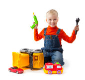 Little boy repairs toy car Stock Image