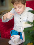 Little boy in restaurant Royalty Free Stock Image