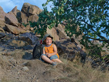 Little boy resting on the mountain in summer Royalty Free Stock Image