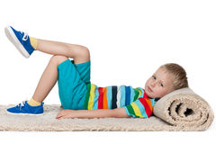 Little boy rests on the carpet Royalty Free Stock Photography