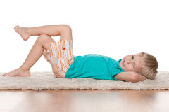 Little boy rests on the carpet Stock Image