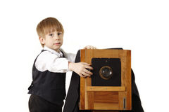 Little boy retro photographer with vintage camera. In studio isolated on white background Stock Photography