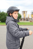 Little boy ride on segway. Near friendship fountain in Moscow, Russia, side stock photography