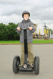 Little boy ride on segway. Near friendship fountain in Moscow, Russia royalty free stock images