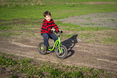 Little boy rides a bicycle Royalty Free Stock Image