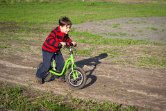 Little boy rides a bicycle Royalty Free Stock Photos