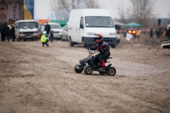 Little boy rides his ATV quad. A little boy rides his black ATV quad 2014 Stock Image
