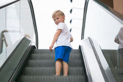 Little Boy Riding An Escalator One Dangerous. Stock Images