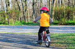 Little boy riding away from Royalty Free Stock Photos