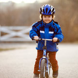 Little boy, riding a balance bike Stock Photography