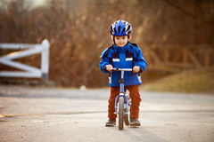 Little boy, riding a balance bike in the park Stock Image