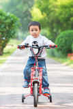 Little boy is riding bicycle Royalty Free Stock Image