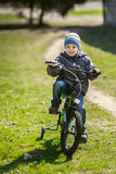 Little boy riding a bicycle in the park Royalty Free Stock Photo