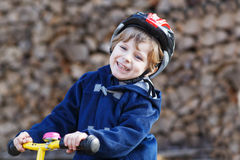Little boy riding bicycle in village or city Stock Photography