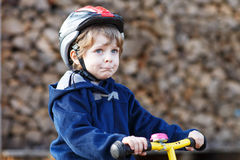 Little boy riding bicycle in village or city Royalty Free Stock Photography
