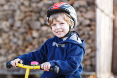 Little boy riding bicycle in village or city Royalty Free Stock Photo