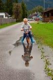 Little boy riding a bike. Stock Image