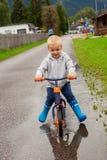 Little boy riding a bike. Royalty Free Stock Image