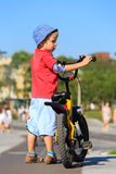 Little boy riding bike in the city Royalty Free Stock Images