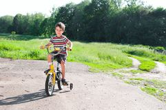 Little boy riding bike on country Stock Photo