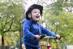 Little boy riding a bike Royalty Free Stock Photography