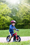Little boy riding a bike Stock Image