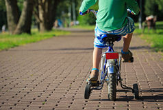 Little boy riding bike in the park Royalty Free Stock Photography