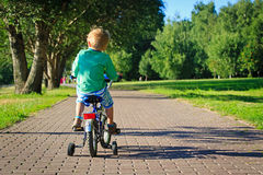 Little boy riding bike in the park Royalty Free Stock Photos