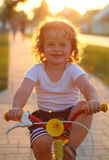 Little boy riding bike in spring park, cycling Stock Photography