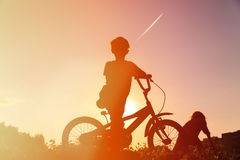 Little boy riding bike at sunset Royalty Free Stock Image