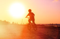 Little boy riding bike at sunset Royalty Free Stock Photography