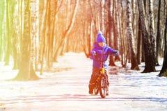 Little boy riding bike in winter, kids sport Stock Image