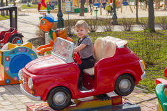 Little boy is riding the car Royalty Free Stock Photos