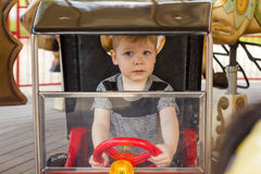 Little boy is riding the car Stock Image