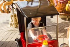 Little boy is riding the car Royalty Free Stock Image