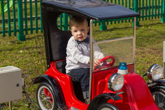 Little boy is riding the car Royalty Free Stock Photo