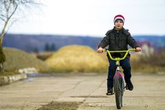 Little boy riding his bicycle in park outdoors. Royalty Free Stock Photos