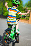 Little boy riding his bike Royalty Free Stock Photos
