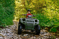 A little boy riding on a quad bike Stock Photography