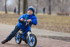 Little boy riding runbike Royalty Free Stock Image