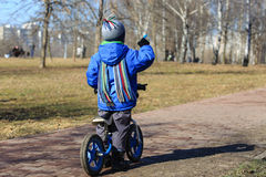 Little boy riding runbike, early sport Royalty Free Stock Images