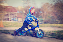 Little boy riding runbike Royalty Free Stock Photos